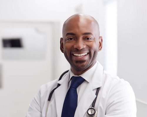 portrait-of-mature-male-doctor-wearing-white-coat-H49URGD-b.jpg